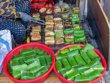 Grilled banana sticky rice in Cambodia street food market