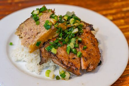 Plate of delicious Vietnam flavored grilled pork chop white rice- Com Tam
