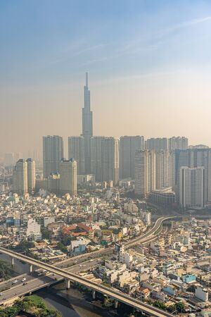 Hazy air polluted industrial city with tall buildings background