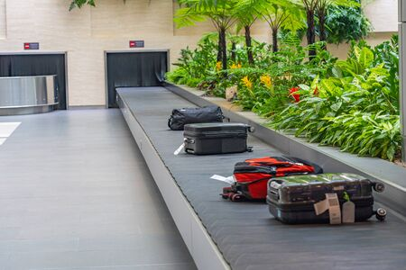 Suitcase or luggage on conveyor belt at airport baggage claim Stock Photo