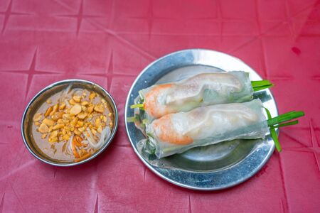 Vietnamese classic fresh spring rolls served with peanut sauce Stock Photo