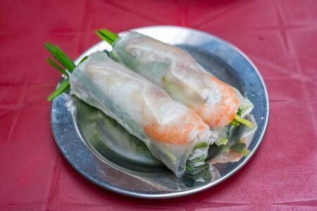 Vietnamese famous local cuisine, fresh shrimp rolls and chives