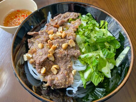 Vietnamese braised beef rice noodle served with vegetables and peanuts Stock Photo