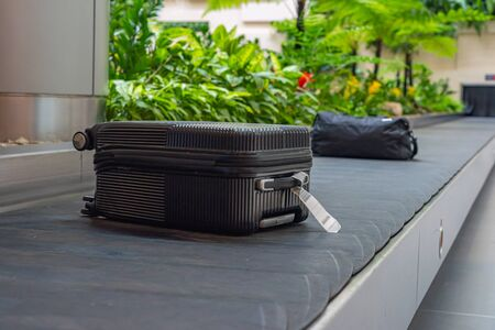 Passenger luggage on conveyor belt at arrival terminal in airport Stock Photo