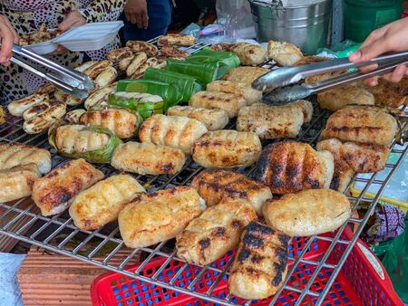 Traditional grilled banana wrapped with sticky rice at Cambodia outdoor market