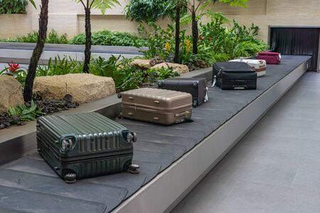 Luggage on conveyor belt at arrival terminal in Changi airport