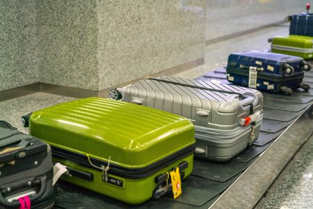 Suitcase and luggage on the conveyor belt in international airport