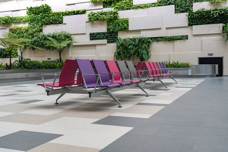 Empty rows of waiting chair at Changi airport, Singapore Stock Photo