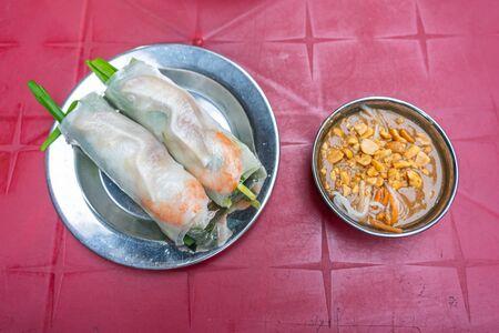 Classic Vietnamese rice paper shrimp rolls served with peanut sauce Stock Photo