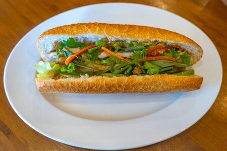 Vietnamese sandwich with chicken meat and scallion- Banh Mi Stock fotó
