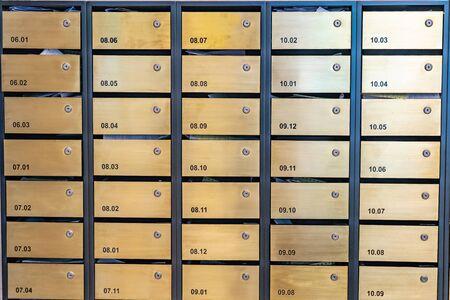 Metallic letter mailbox array at postal room in condominium building