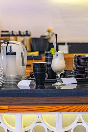 Beverage pickup area at bar counter in coffee shop