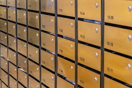 Letter mailbox rows in postal room of condominium building