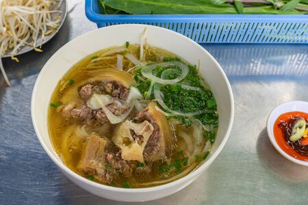 Pho beef noodle soup - local famous and popular Vietnamese cuisine