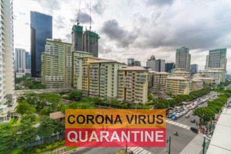 Covid-19 pandemic quarantine sign on blurred capital city background Stock Photo