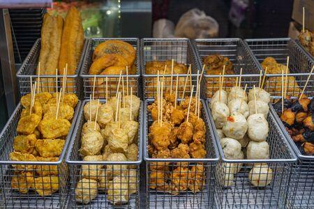 Hong Kong fish ball skewers for sale at food market Stock Photo
