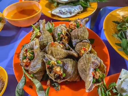 Delicious Vietnamese snails dish cooked with chili and peppercorn