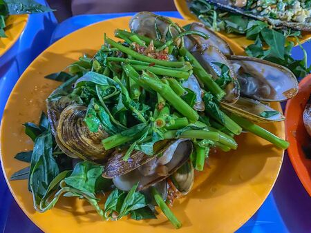 Vietnamese cuisine- stir-fried clams with chili sauce and vegetables