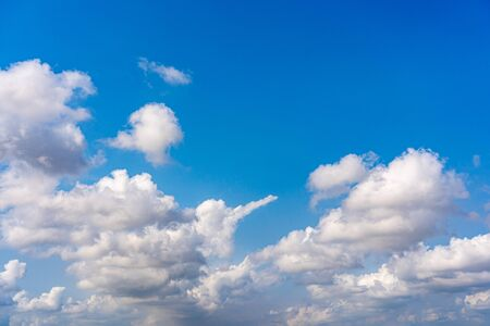 White clouds cumulus floating on blue sky in beautiful weather