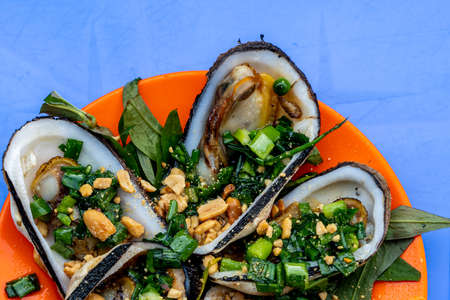 Grilled mussels served with peanut and green onion - Vietnamese cuisine Stock Photo