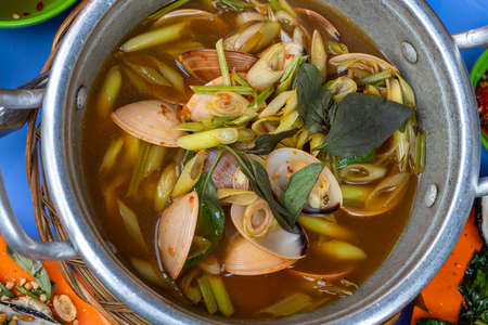 Bowl of spicy clams cooked with lemongrass, chili and tamarind