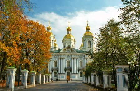 Russian cathedral with three cupola on the foreground