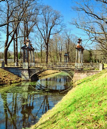 Old metal brige over channel in spring park photo