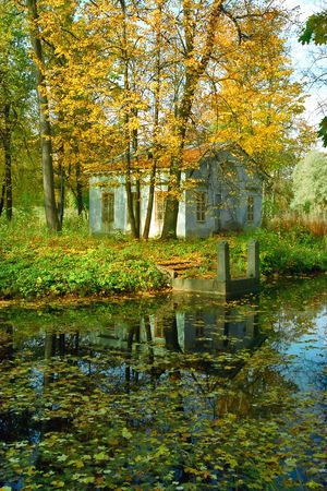 Ancient cottage and quay in the autumn park Stock Photo