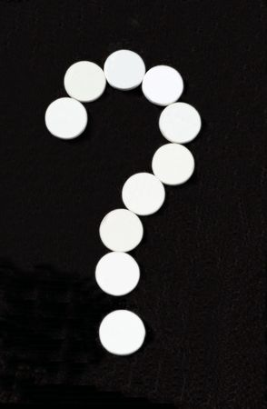 White pill question mark on black