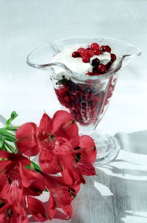 Red berry with cream and flower close up Stock Photo