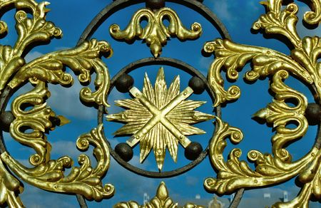 Fragment of figured golden grating with symbol Stock Photo