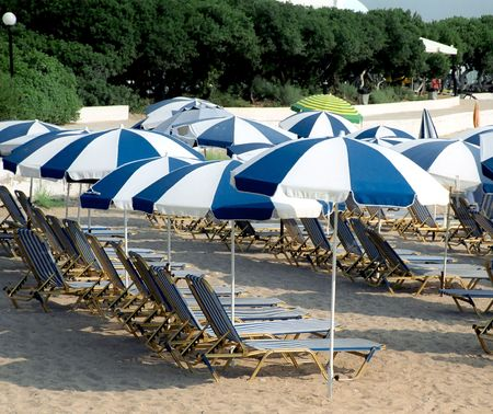 Umbrellas and sun beds on the sea shore