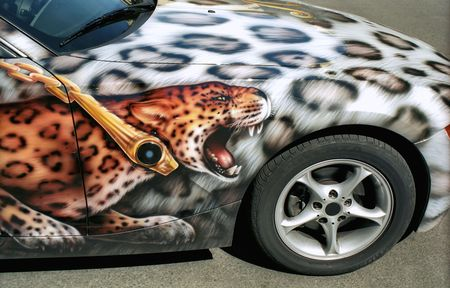 Leopard aerography and pattern on the surface of the car