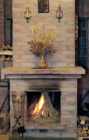 Fireplace with flame in village house