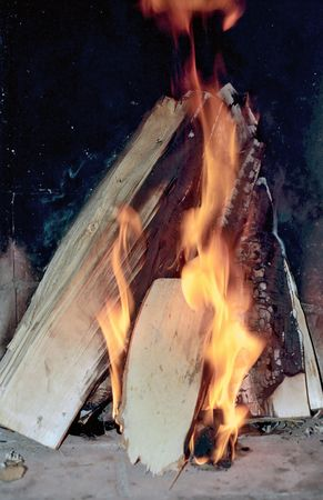 Flame and wirewood in fireplace photo