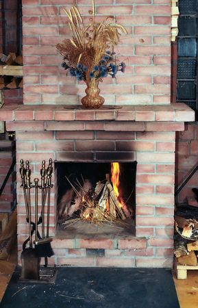 Village house fireplace with vase on  mantelshelf Stock Photo