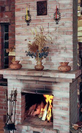 dead flowers: Village kitchen fireplace with dead flowers on mantelshelf