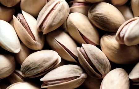 Open salted pistachio background Stock Photo