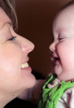 Mother and daughter happy faces close up Stock Photo