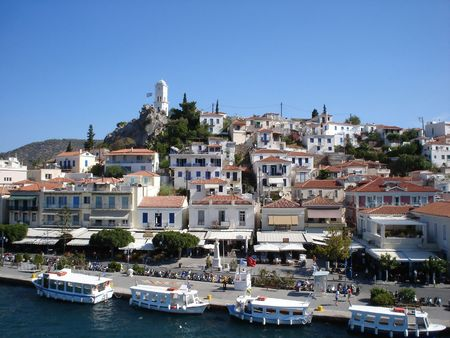emphasized: Heart of Poros town with Clock Tower on the hill