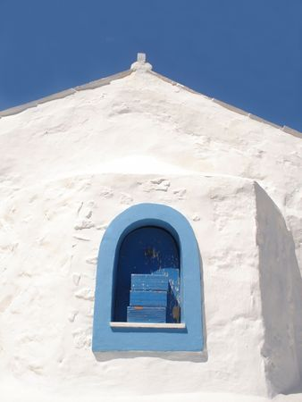 White wall of a greek church on blue sky background Stock Photo - 4587701