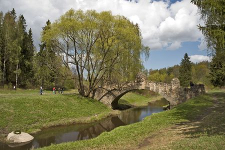 Ancient bridge at the riverside in spring sunny day photo
