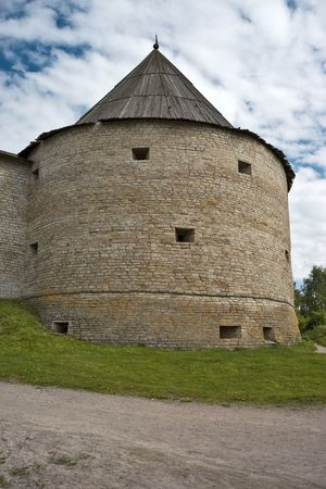loophole: Fortress tower with portholes and conic roof