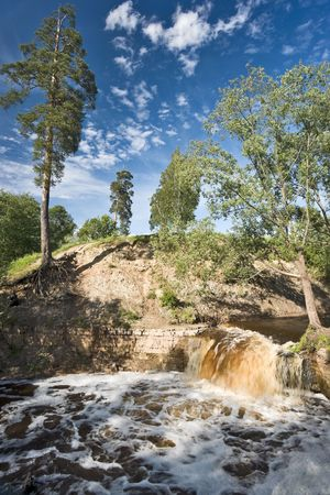 Small boisterous waterfall of a northern river photo
