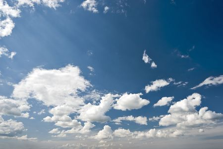 gleams: Picturesque blue sky with white clouds and sun gleams