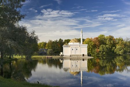 Autumn landscape with mosque near pond in the beautiful park photo