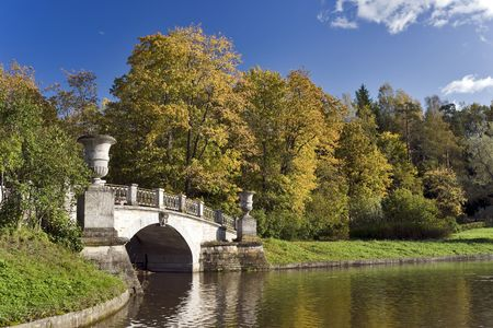 Classical bridge in the autumn park Stock Photo
