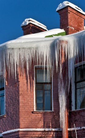 Icicles and snow on the building