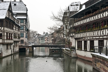 Strasbourg old half-timbered houses and river in winter