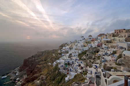 Santorini sundown to clouds in Ia village  photo